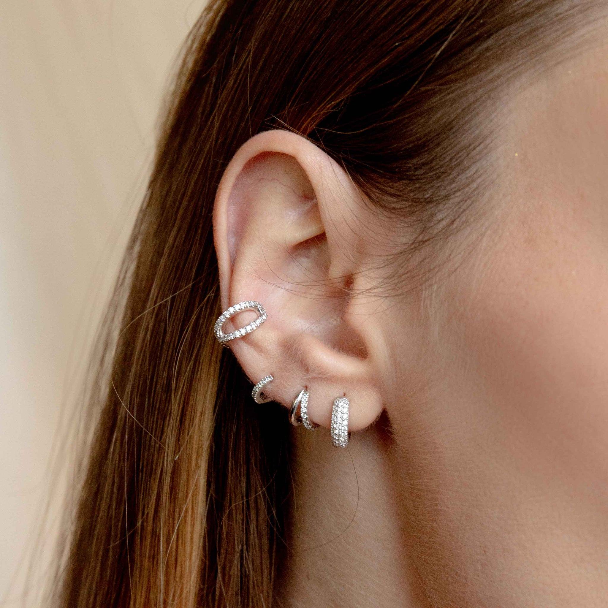 Crossover Crystal Ear Cuff in Silver worn with huggies and clickers