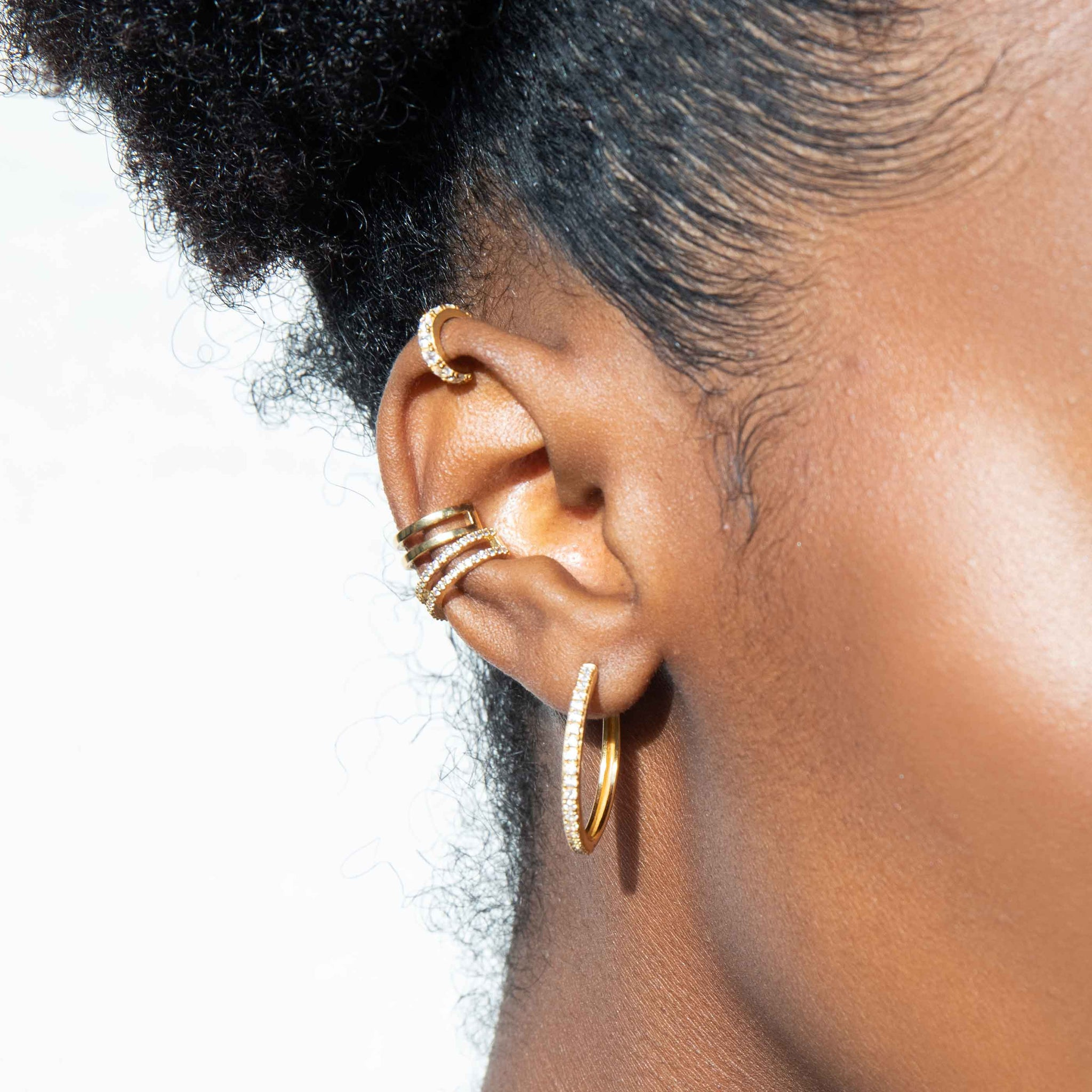 Mini Wishbone Ear Cuff in Gold worn with hoop earrings