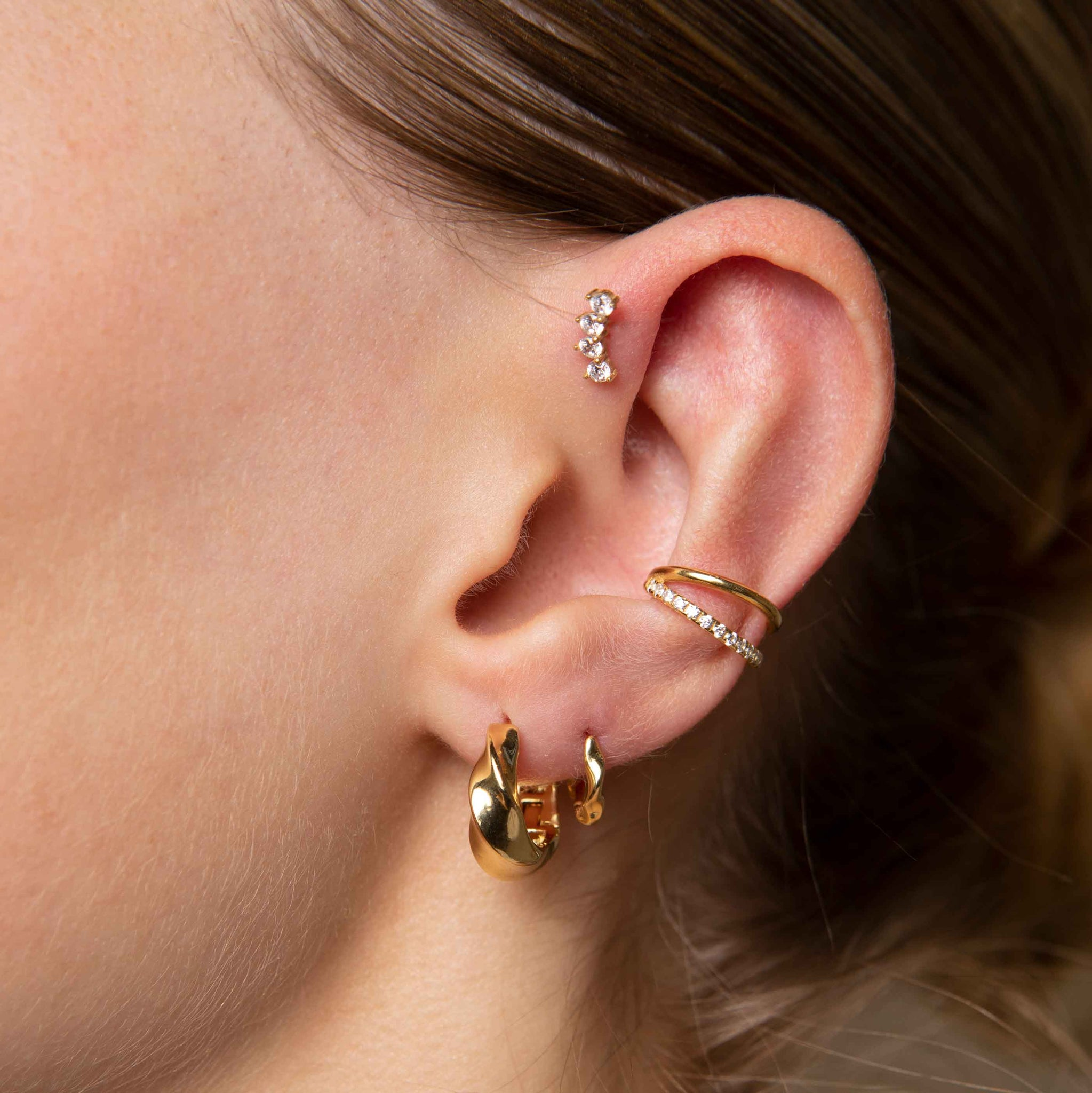 Elemental Hoops in Gold worn with elemental huggies and illusion crystal ear cuff
