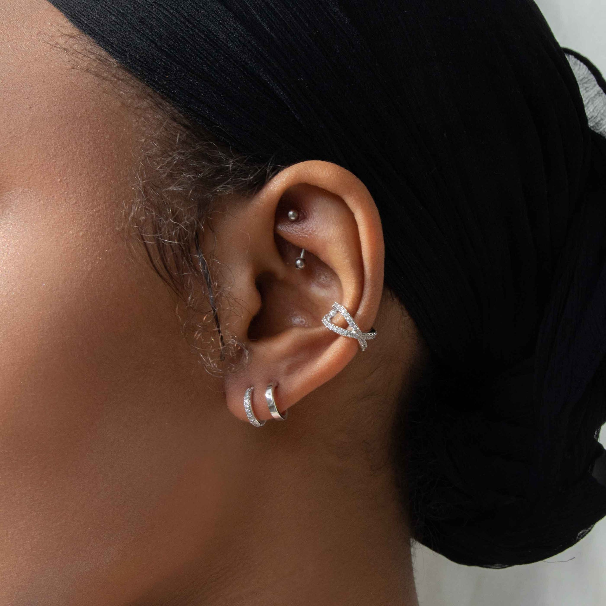 Illusion Stud Earrings in Silver worn with ear cuff