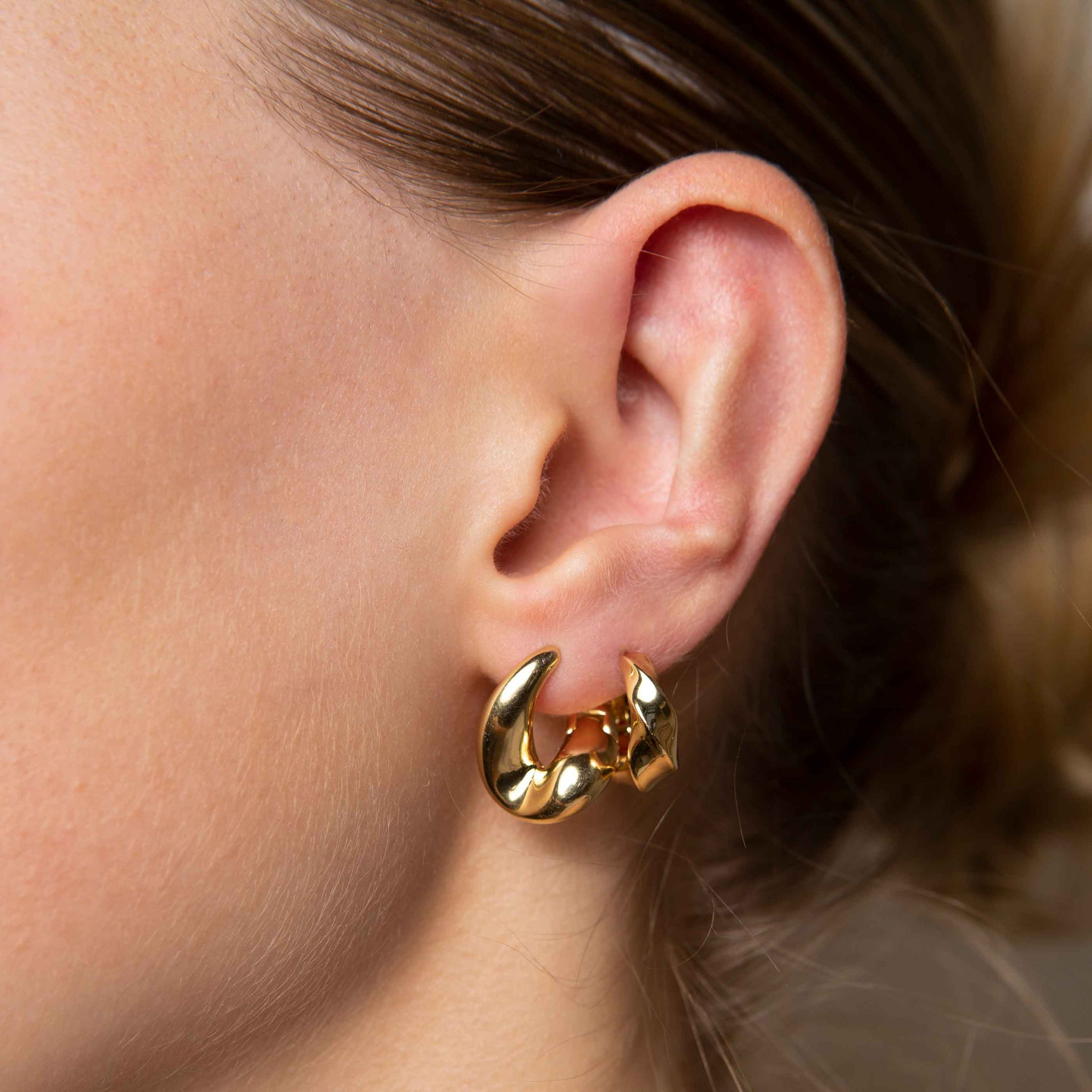 Elemental Hoops in Gold worn with molten hoops