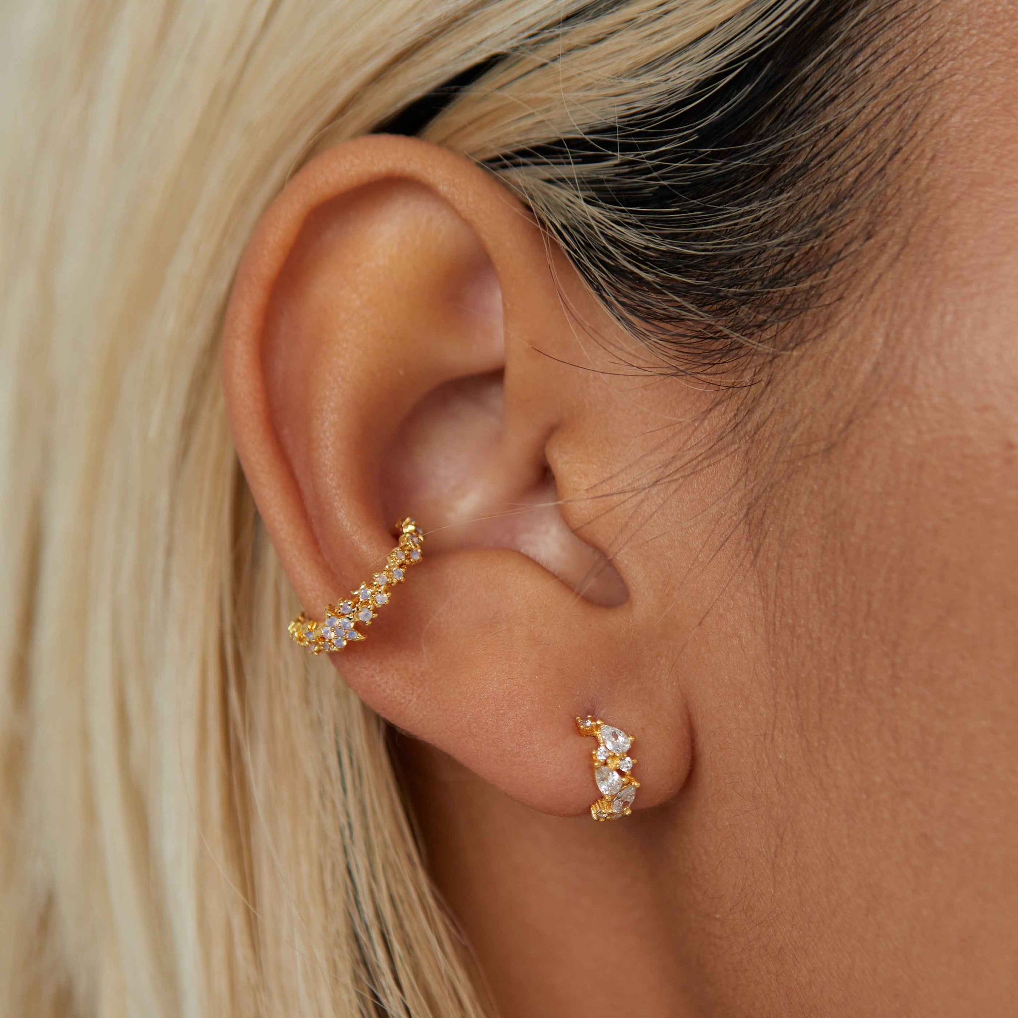 Mystic Crystal Huggies in Gold worn with mystic ear cuff