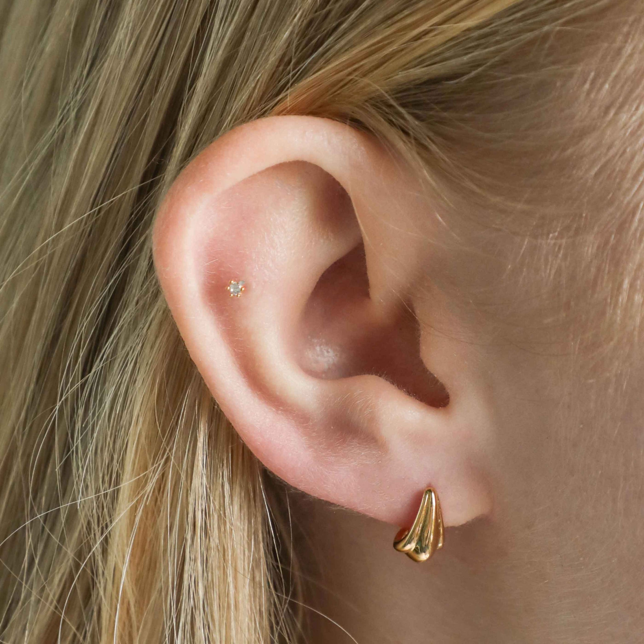 Petal Stud Earrings in Gold worn in first lobe piercing