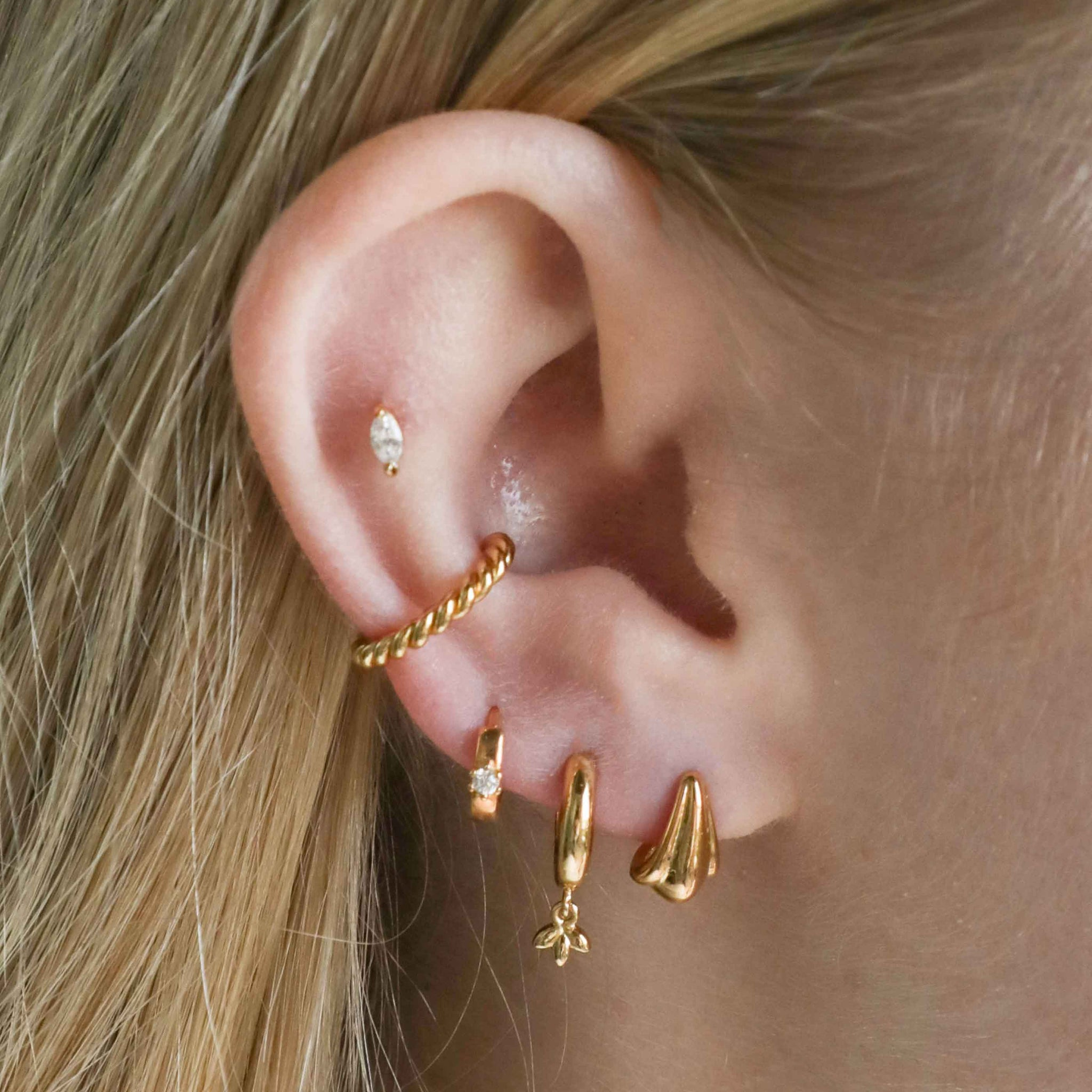 Petal Stud Earrings in Gold worn with huggies and ear cuffs
