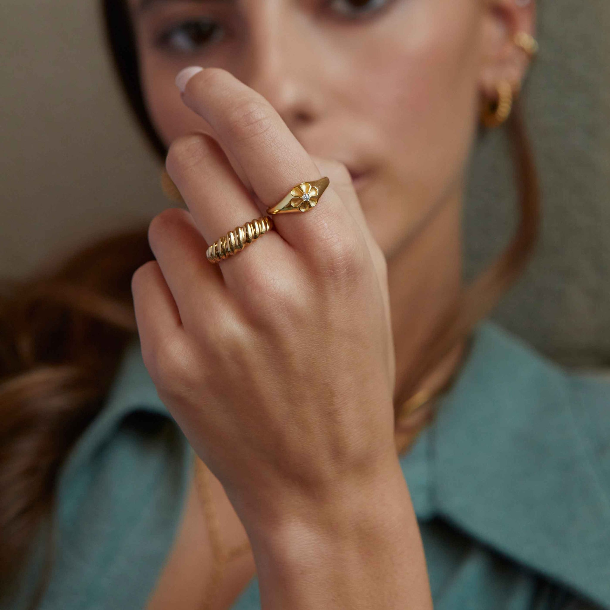Rope Dome Ring in Gold worn with flora signet ring