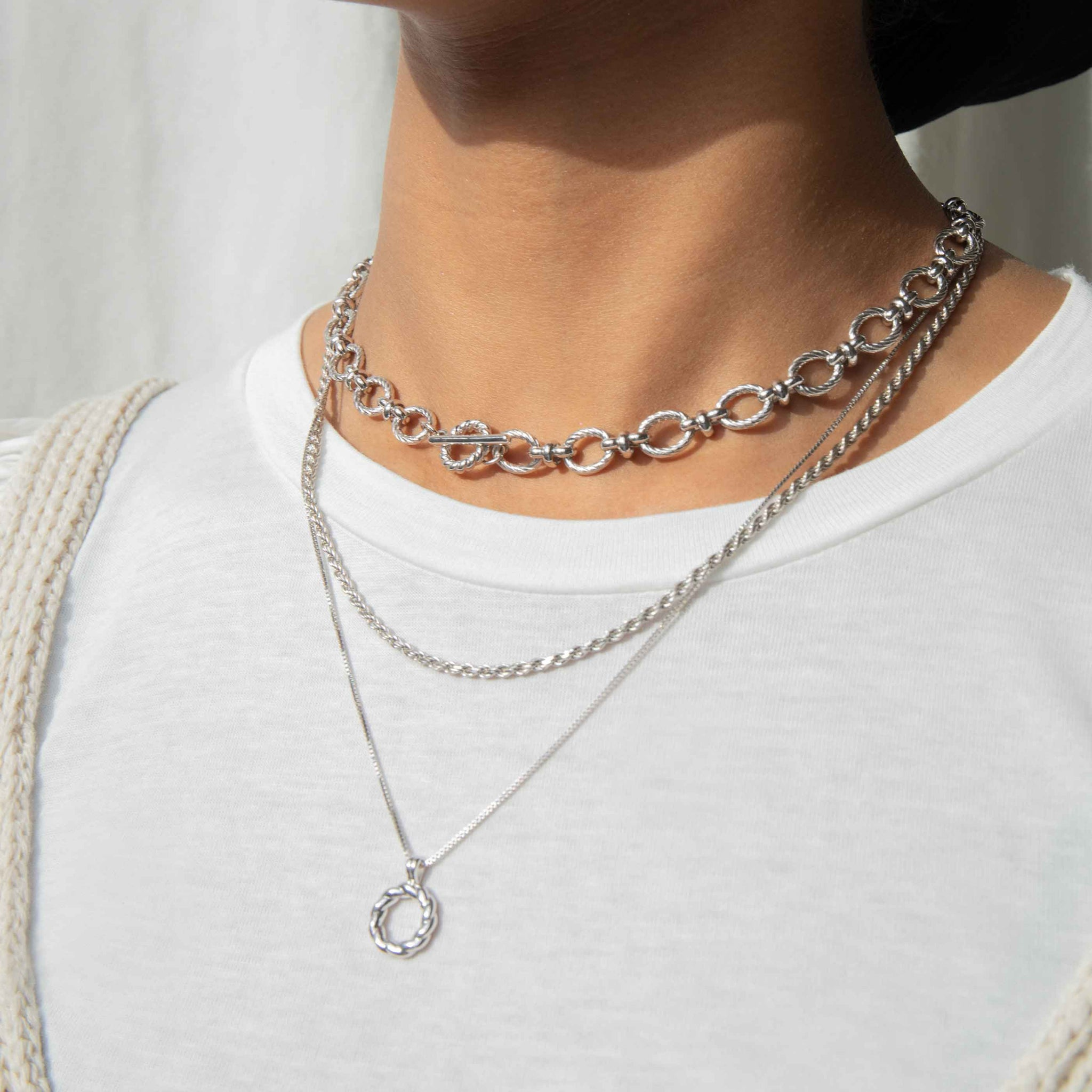 Rope Ring Pendant Necklace in Silver worn with chunky chains\