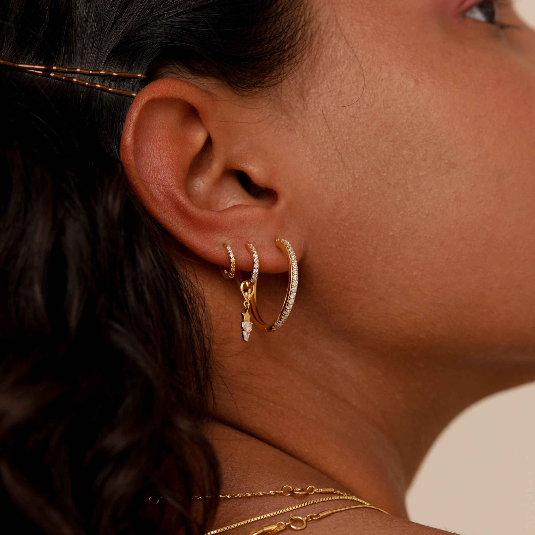 Single Dia Base Hoop in Gold worn with star earring charms