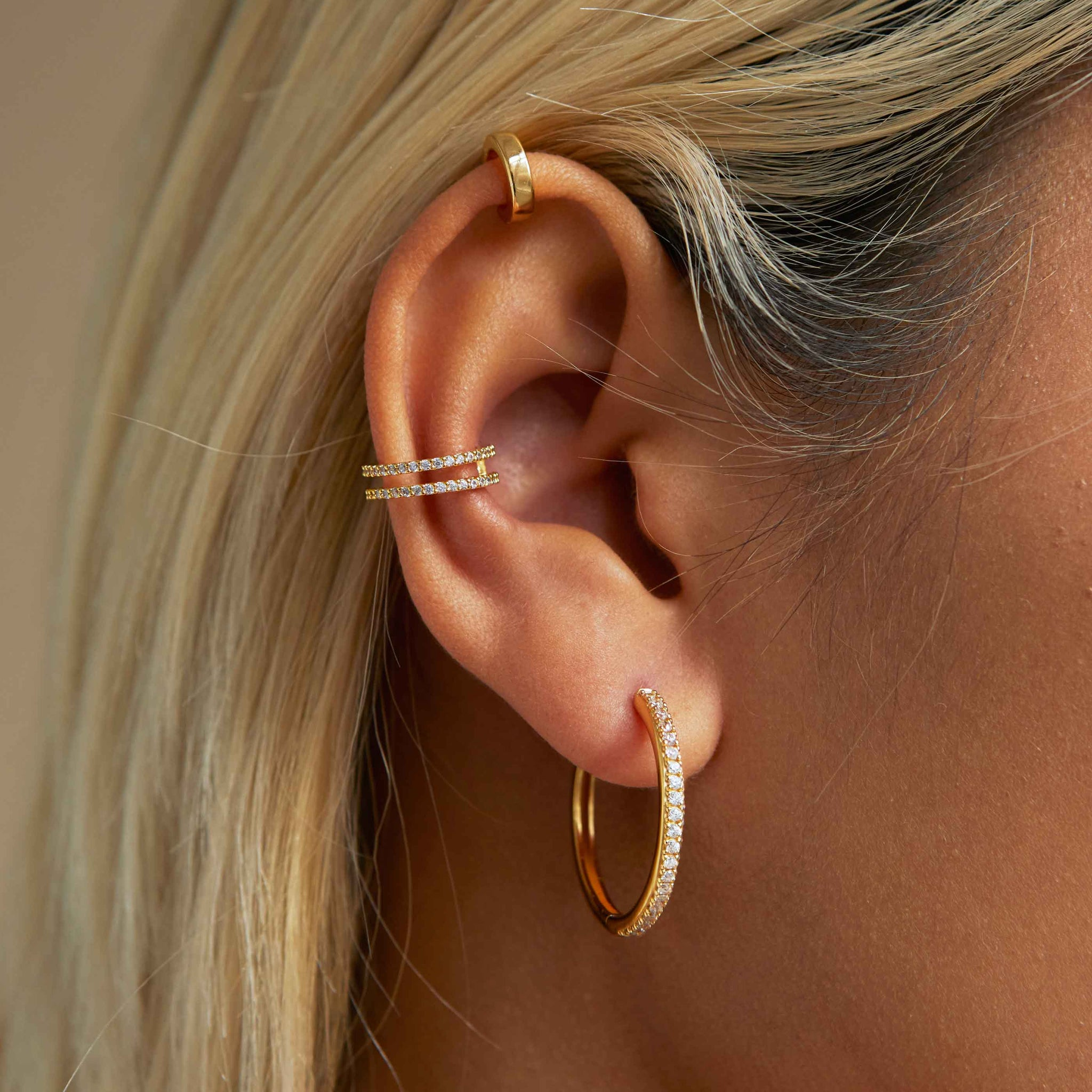Wishbone Ear Cuff in Gold worn with crystal hinge hoops