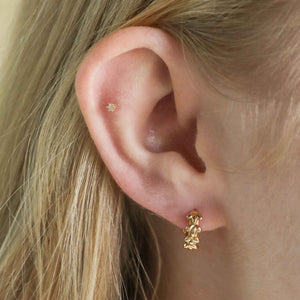 Flora Tiny Barbell in Gold worn in outer conch piercing