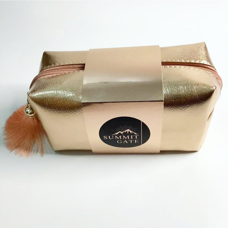 gold luxury style faux leather cosmetic pouch with tassel | luxury style