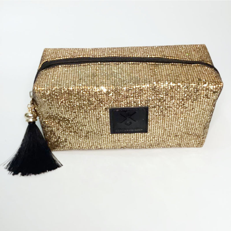 gold glitter cosmetic pouch with tassel sequins | glitter vanity party