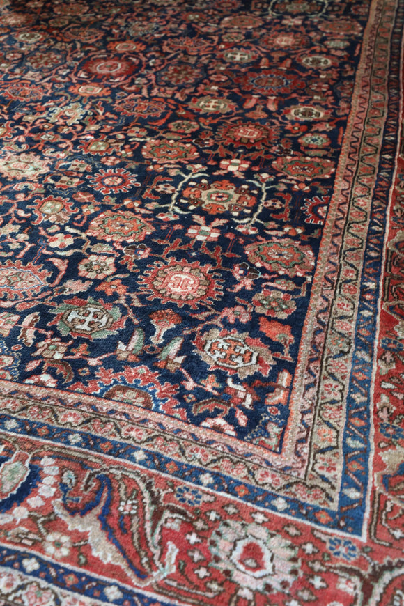 No. 0279 80 year old dark background floral design Oriental rug
