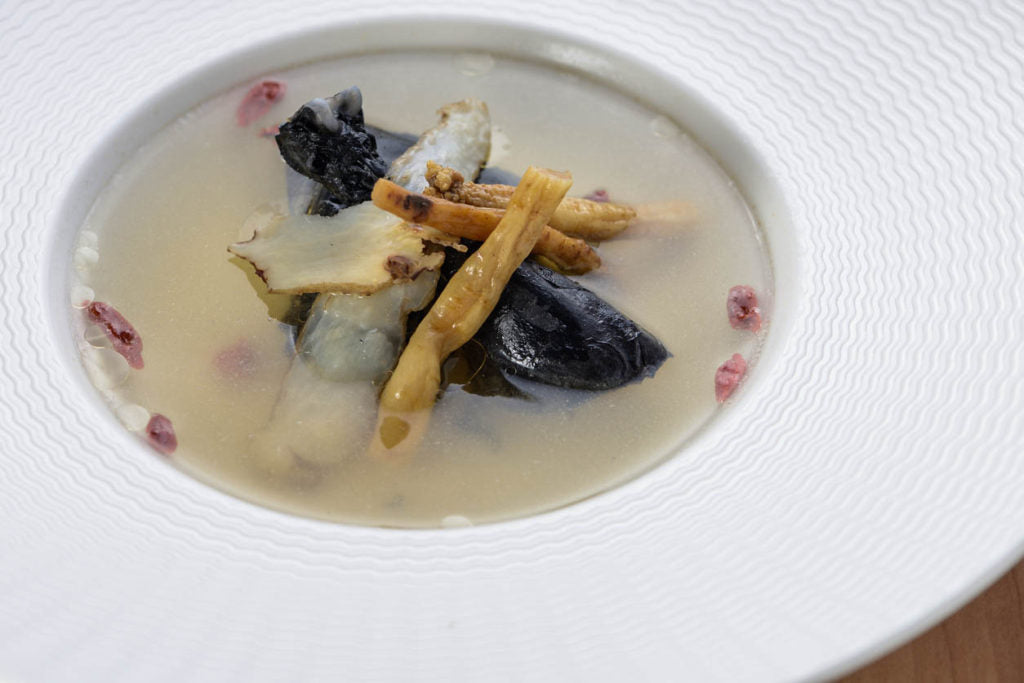 Traditional black chicken soup