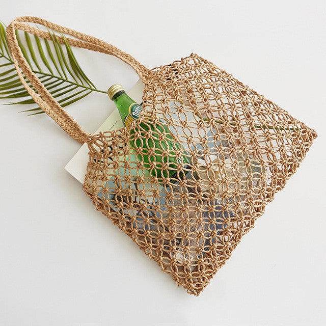 Hand-woven straw bag with rope grid