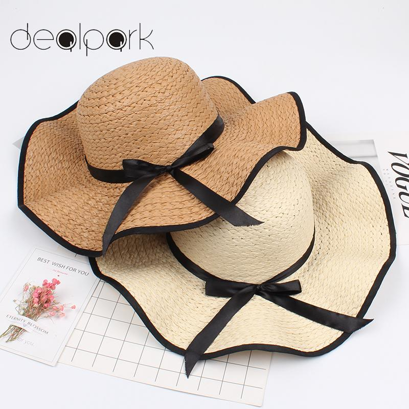 Elegant Sun Hat with Floppy Brim and Bownot