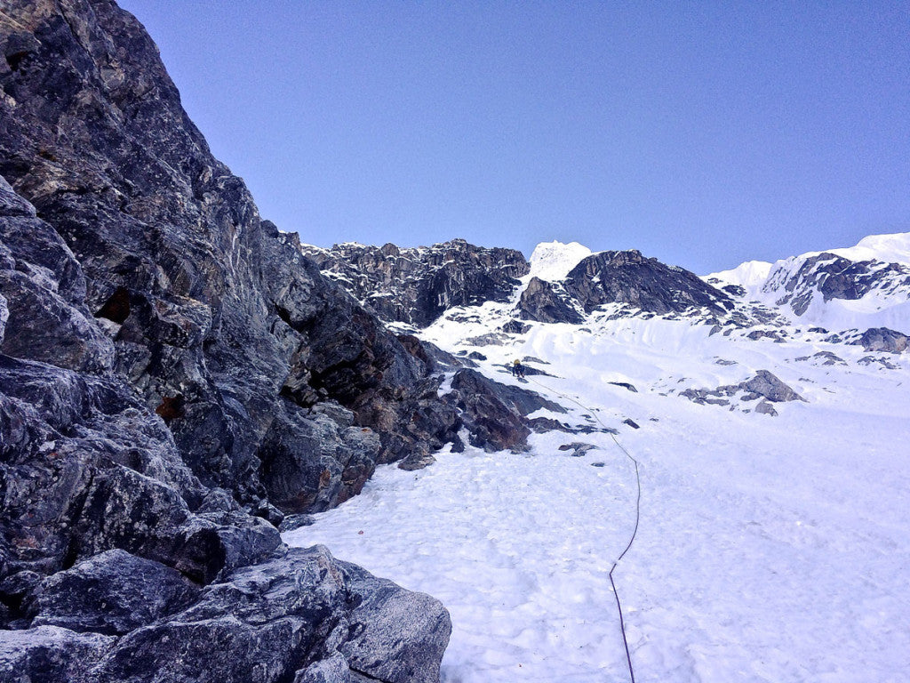 Nik climbing some steep snow and neve in the middle of the West Face of Chugimago.