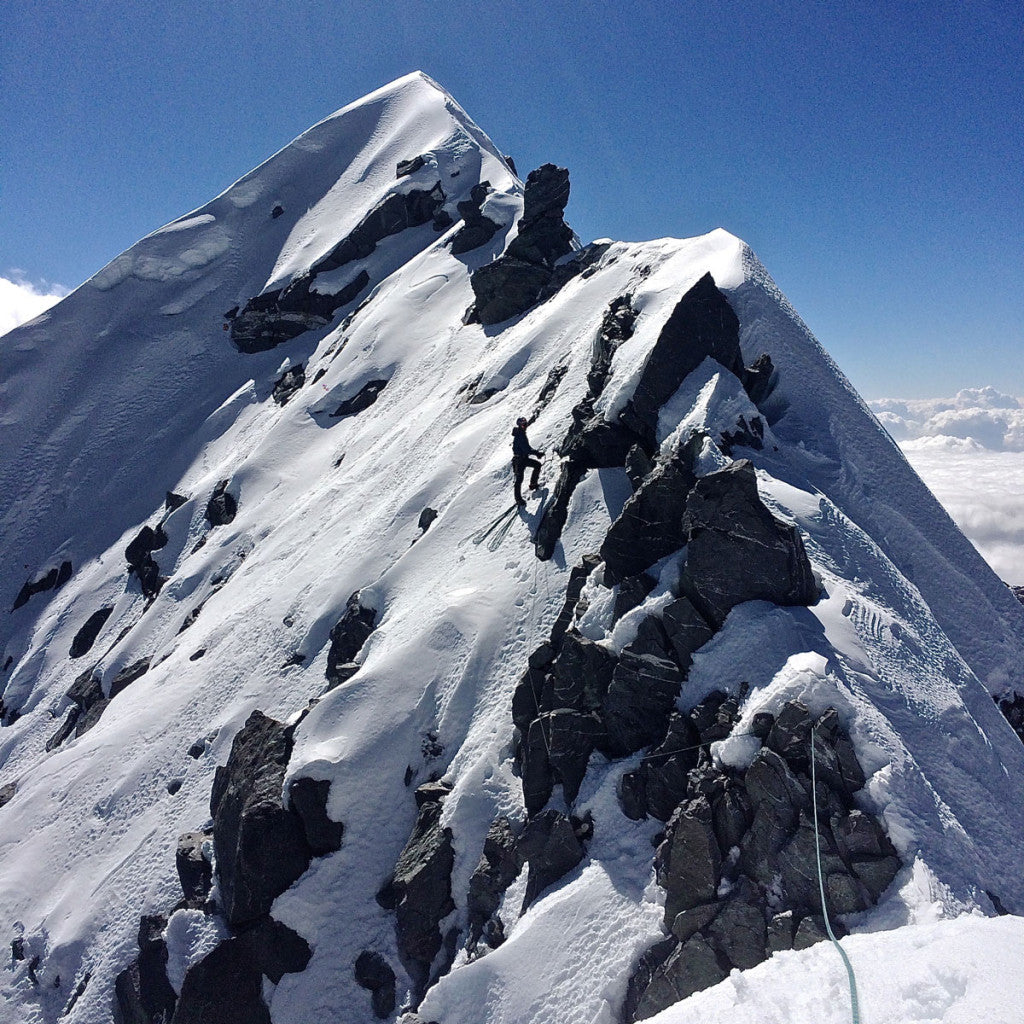 "Nik Belays just below the North summit of Chugimago North (5945m) after climbing our new route ""Witness the Sickness"" (M4, AI4, 75 Deg, 500m)"