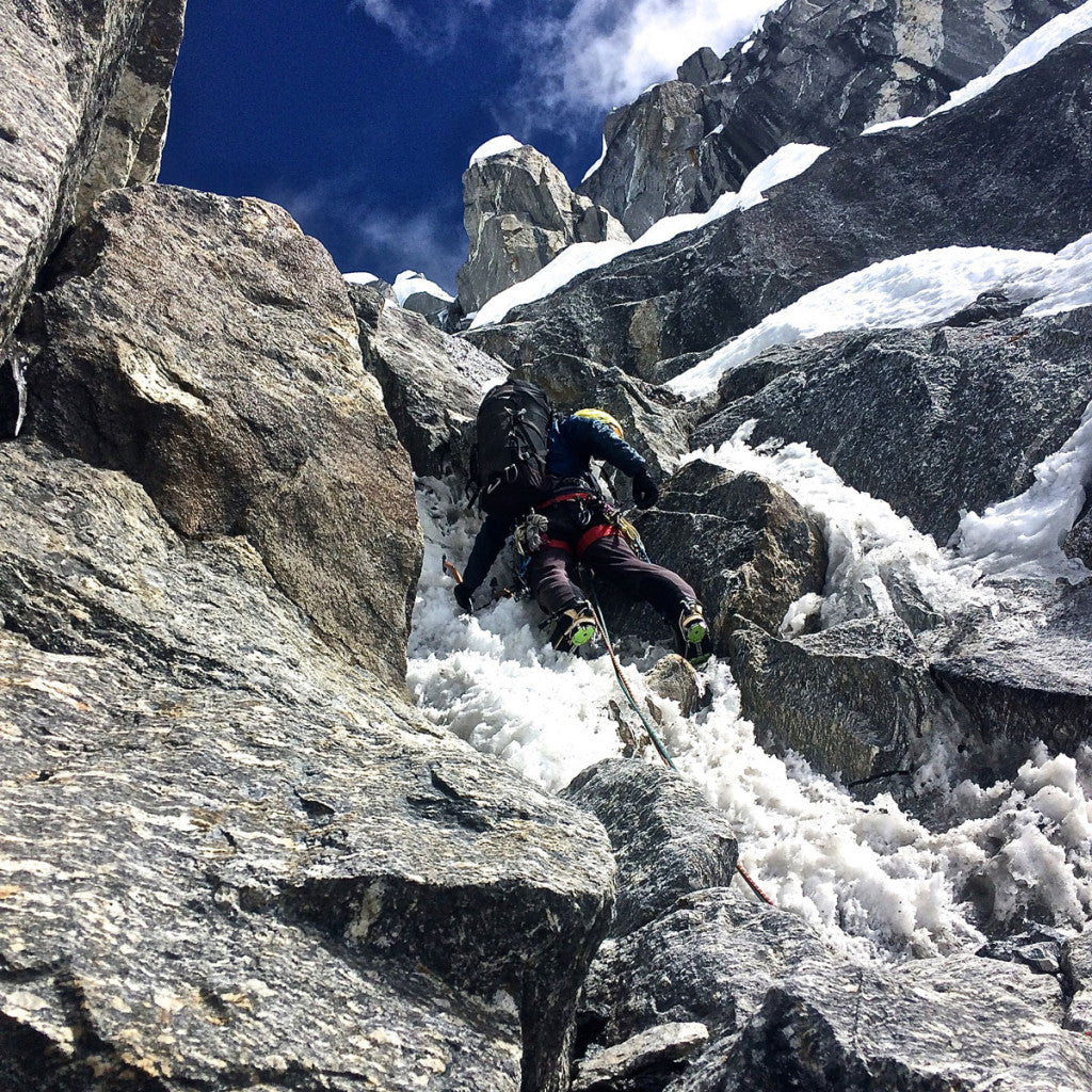 "Mark leads up into one of the crux pitches on Chugimago (6259m) en route to establishing ""Mixed Emotions"" (M6, AI5, 80 deg, 900m)"