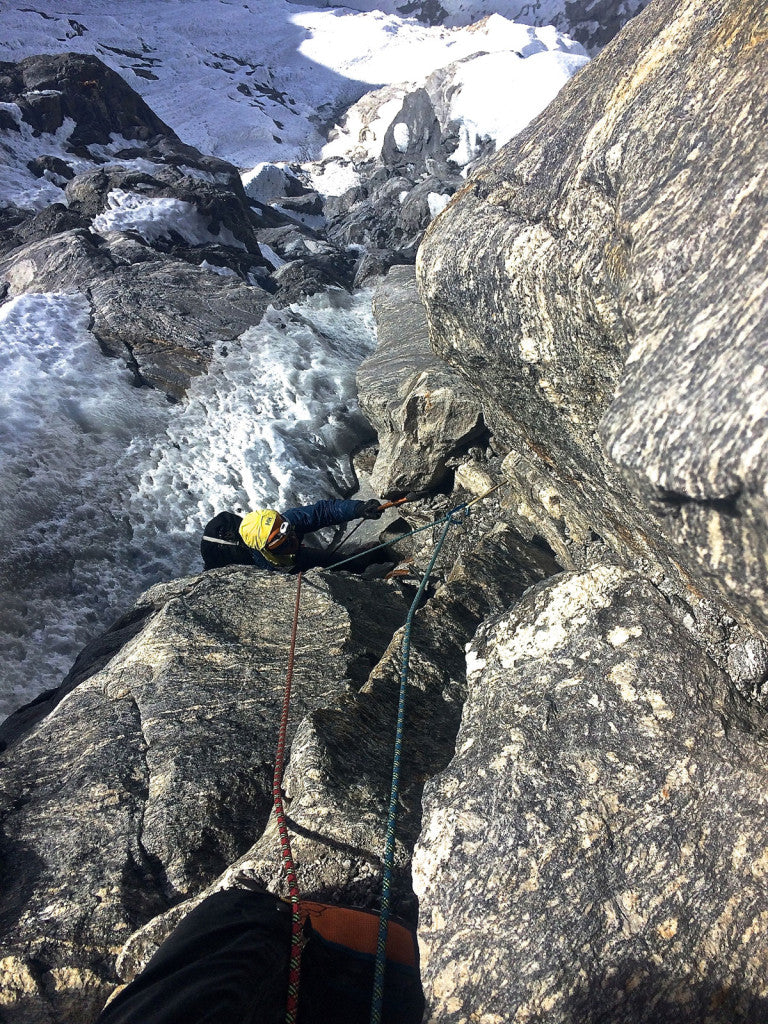 """Mark following through the crux mixed pitch on """"Mixed Emotions"""" on the West Face of Chugimago."""