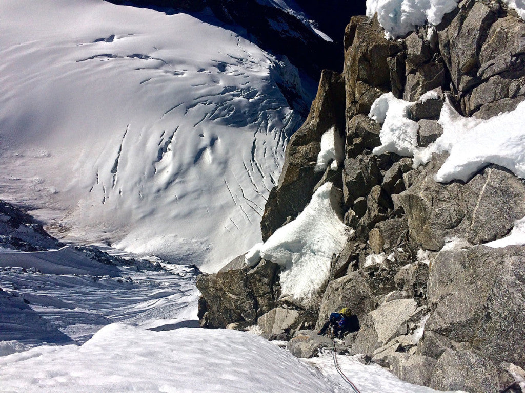 "Nik following one of the last steep mixed pitches on the headwall of ""Mixed Emotions"", West Face of Chugimago."