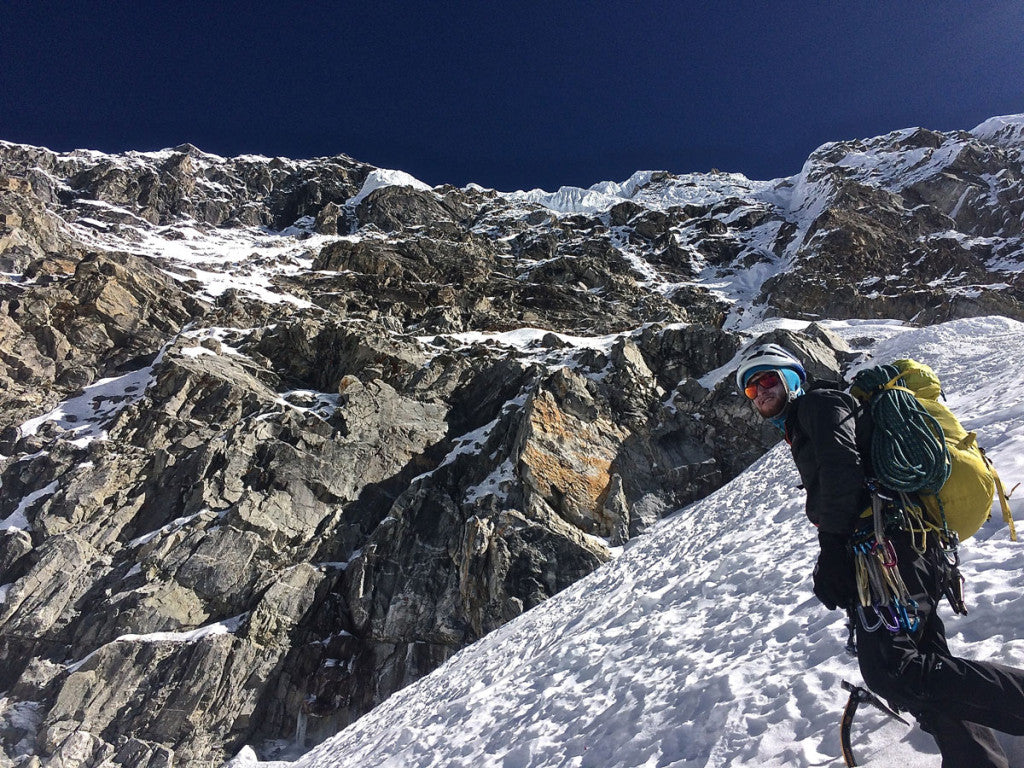 Nik standing just below the schrund as the West Face of Chugimago towers above, just after finishing the descent.