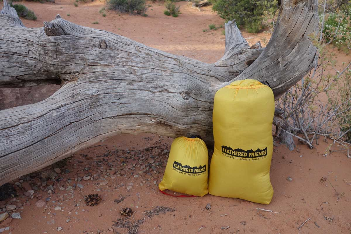 A jacket and sleeping bag stuff into small sacks for travel, but it is best to never store them in these small sacks for long periods of time. Instead, store on a hanger (for jackets) and in the cotton sack that comes with each sleeping bag.