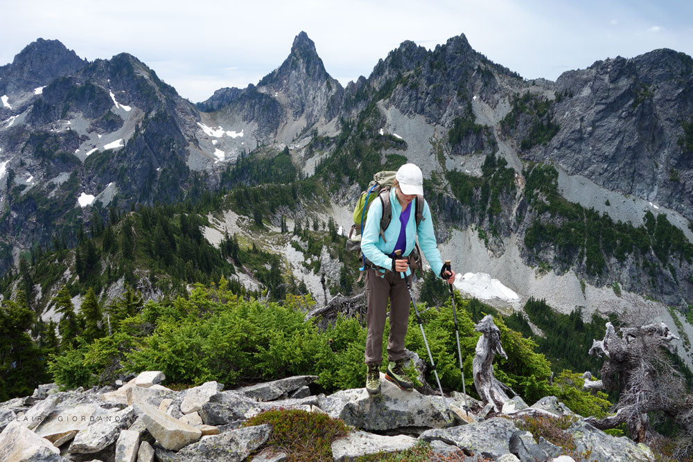 Navigating rocky terrain on a peak in the Alpine Lakes Wilderness.