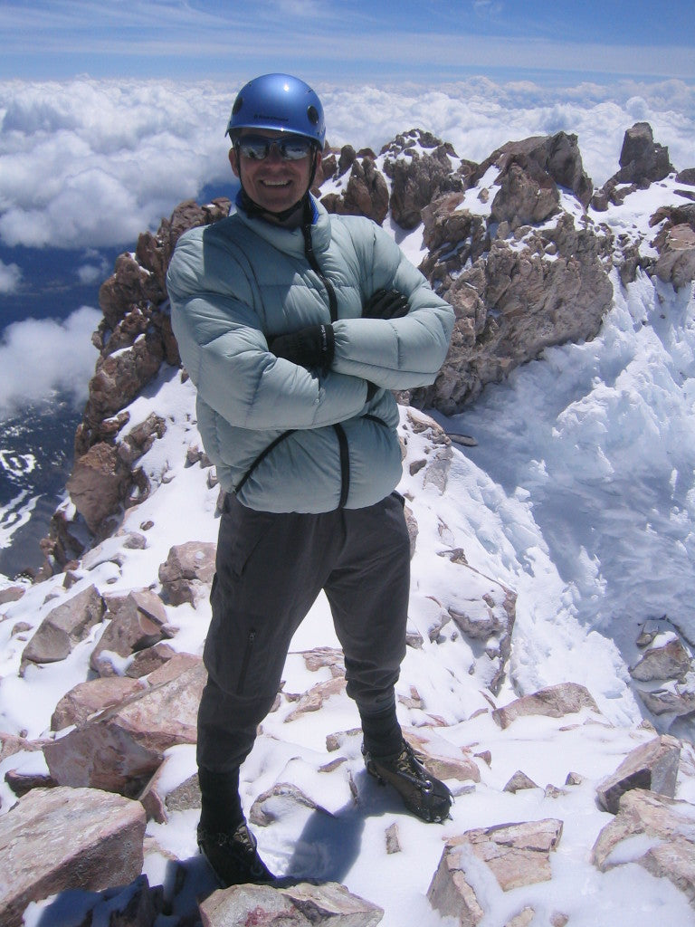 Mike in a Feathered Friends Helios jacket at the summit of Mt. Shasta, 2003.