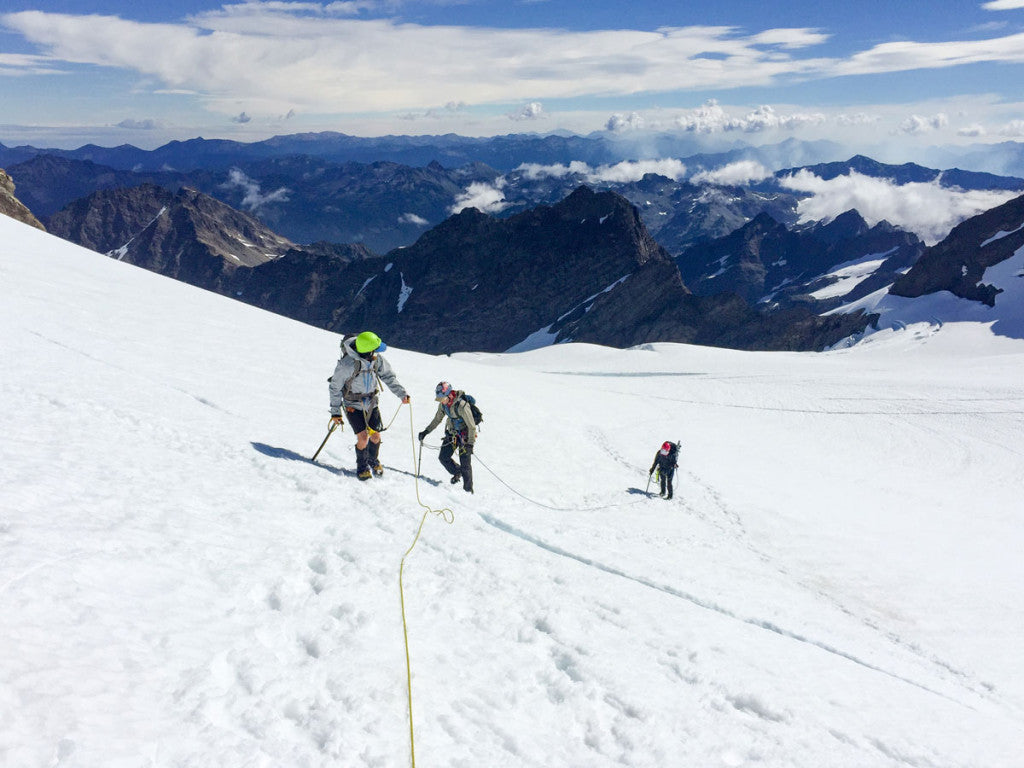 Adding snow to your adventure requires the proper gear and the knowledge of how to use it. Here, Meghan and her friends safely travel glaciated terrain with crampons, rope, and ice axes.