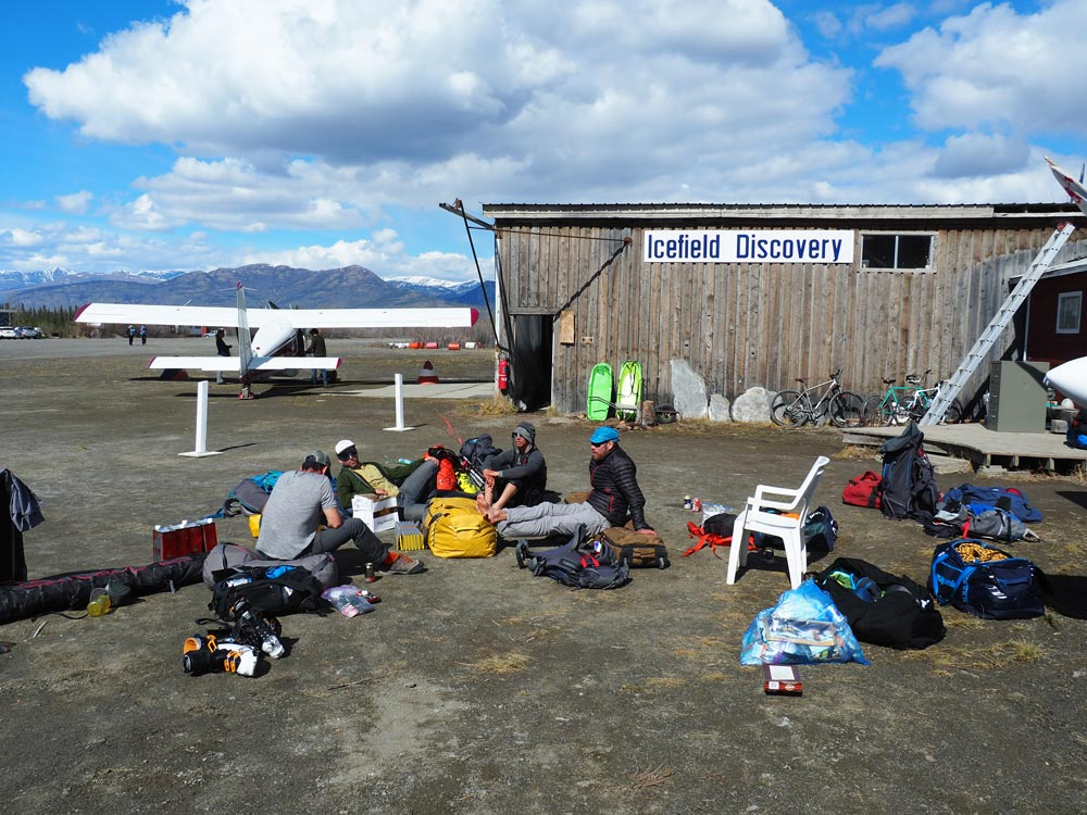 In a daze, the team sips half-frozen beers and contemplates the joys of warm feet at the Icefield Discovery airstrip on Kluane Lake.