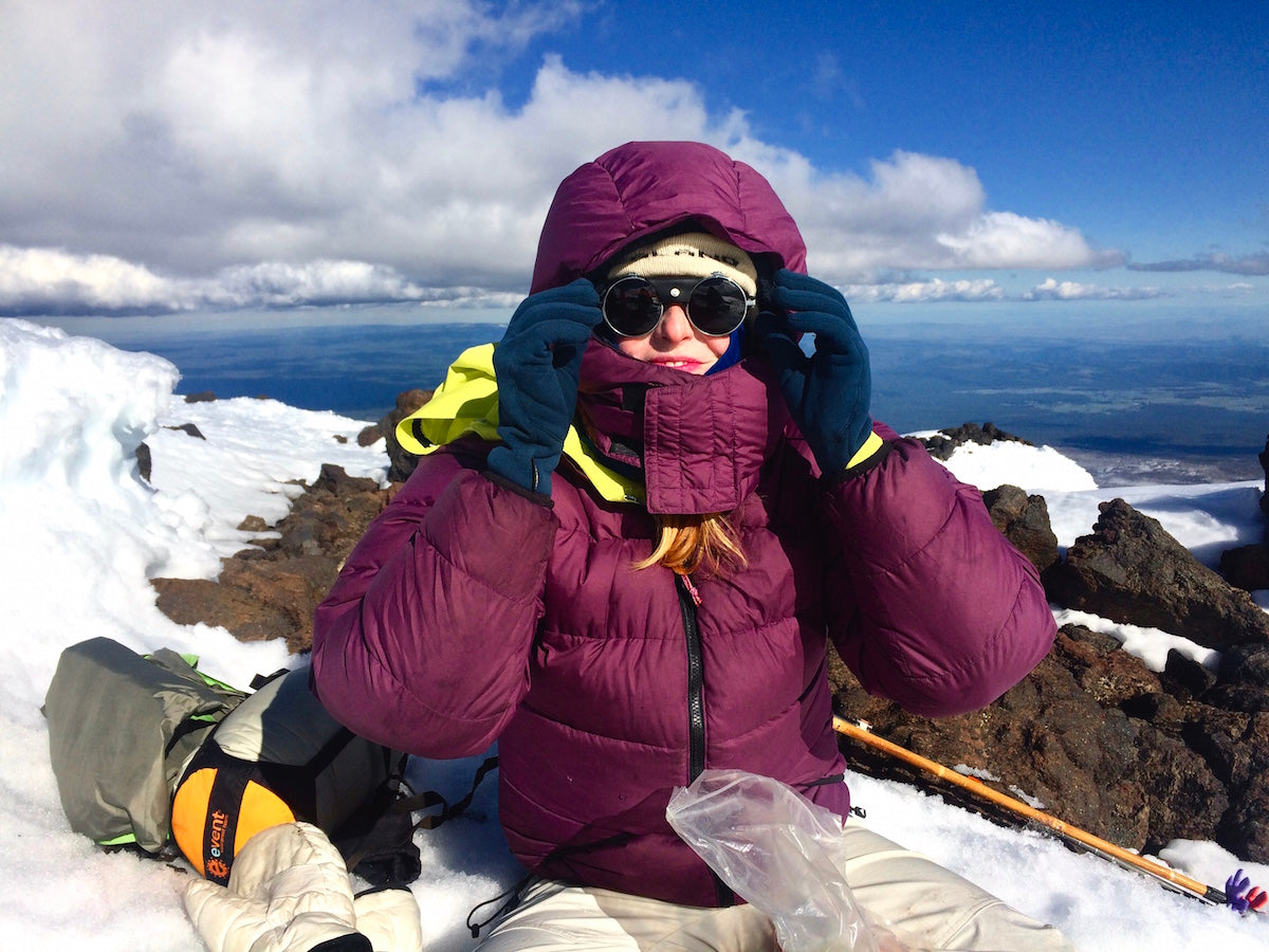 Madeline in a Helios Hoody atop Mt. Adams.