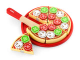 Slicing Pizza on a Red Plate with Spatula & Toppings