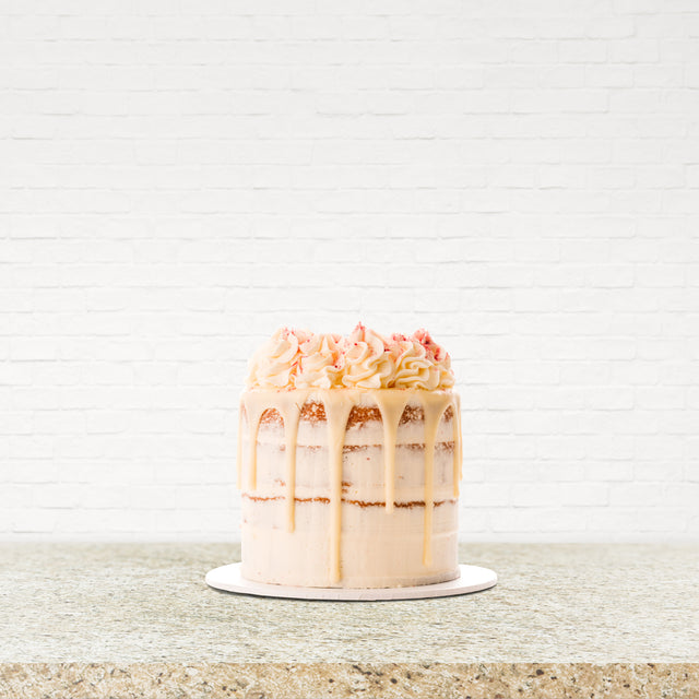 8 Inch Gourmet White Chocolate & Raspberry Drip Cake