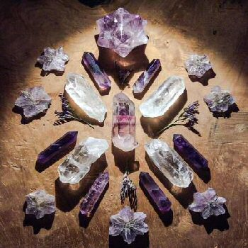 Crystal Grids and Crystal Maps