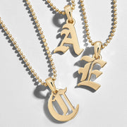 Gold Squiggle Initial Pendant Necklace
