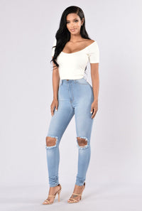 High Waist Knee Ripped Button Up Jeans