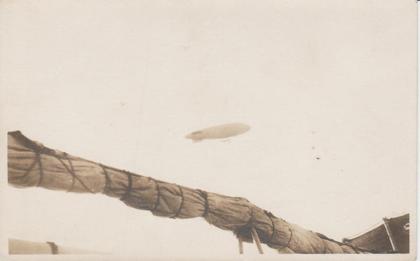 Airship Above Sailing Ship - circa 1915