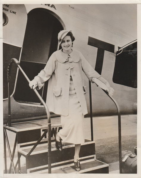 "Press Photo, Sister of ""Upside-Down Stomach Girl"" Boards TWA Flight - 1935"