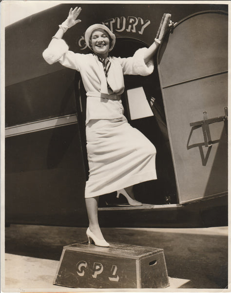"Press Photo, ""Her Smiles Sends Her Miles"" - 1932"