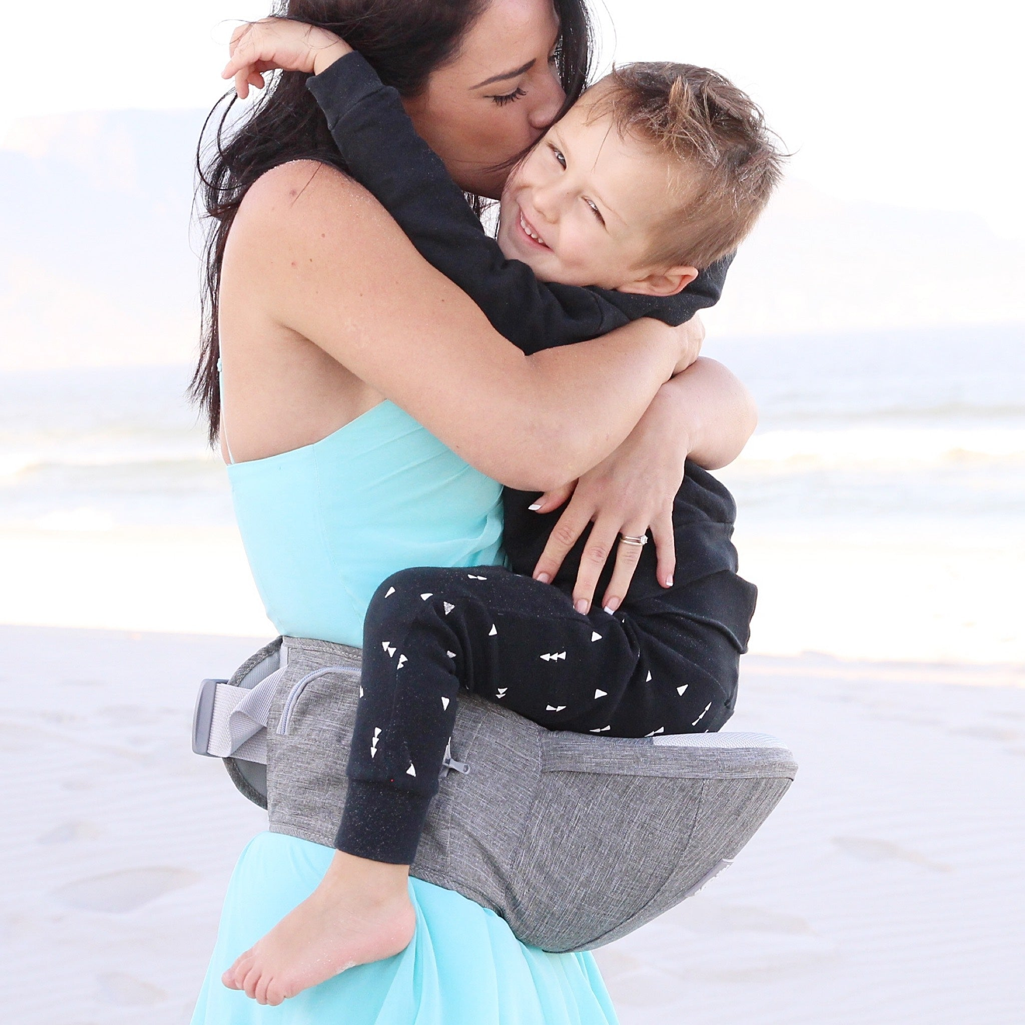 Mom carrying toddler on hip.