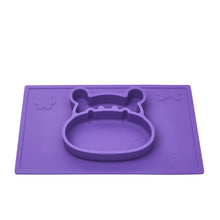The Grippo 2-in-1 placemat in Plum and plate suctions to clean flat surfaces.
