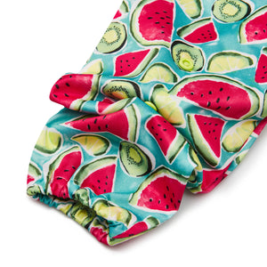 PUL fabric in a kiwi design with popper buttons.