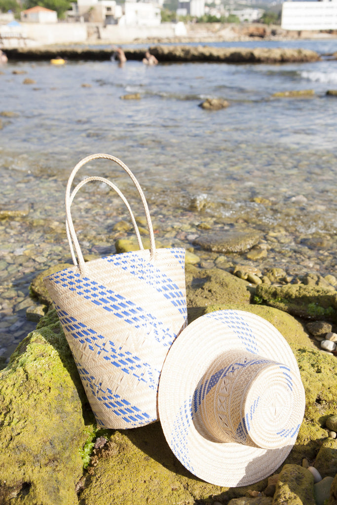 blue straw hat and bag in the beach