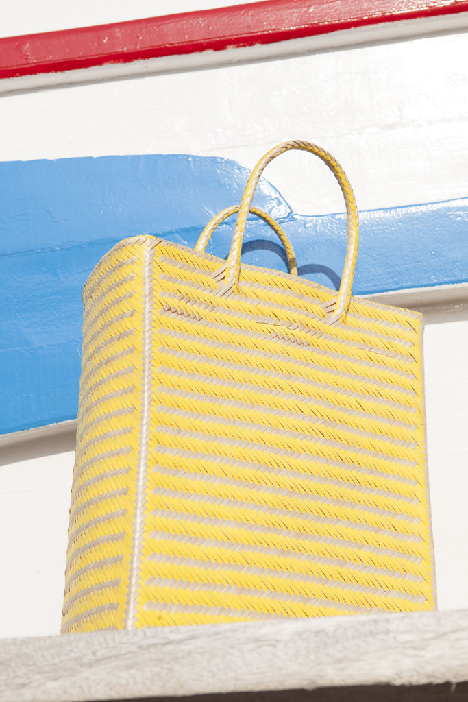 yellow basket squared bag in a sunny weather