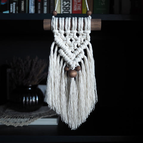 small macrame wall hanging Sicilia on a dark wood dowel
