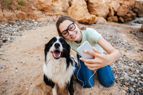 Woman taking a selfie with her dog.