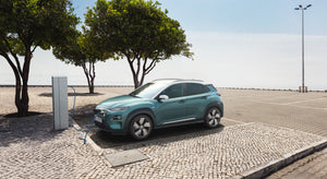 Hyundai Kona electric car on charge in  beach side location.