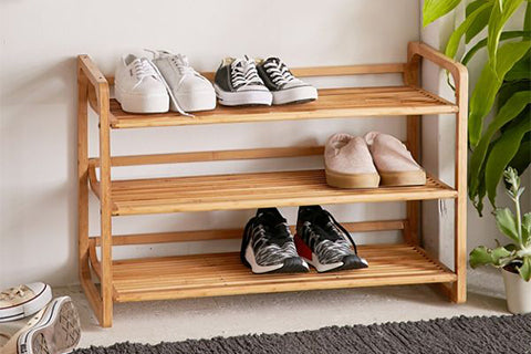 A shoe rack is perfect for reinforcing your no-shoe policy! Photo by Urban Outfitters.