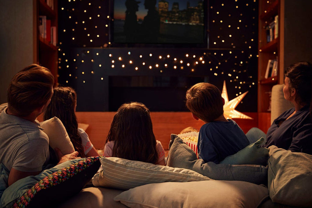 """<a href=""""https://www.businessinsider.com/making-a-family-movie-night-at-home"""">Monkeybusinessimages/Getty Images</a>"""