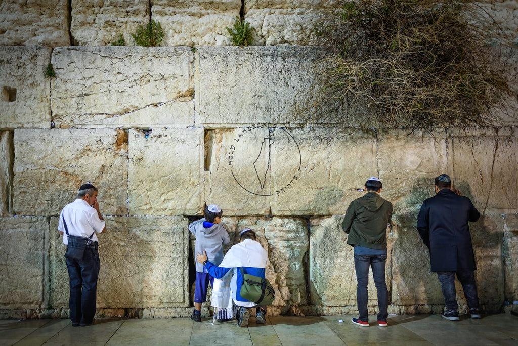 Father and son praying in the Western Wall Art Prints
